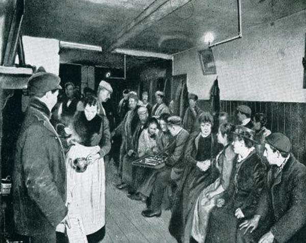 People in the kitchen of a Victorian common lodging house in Spitalfields.