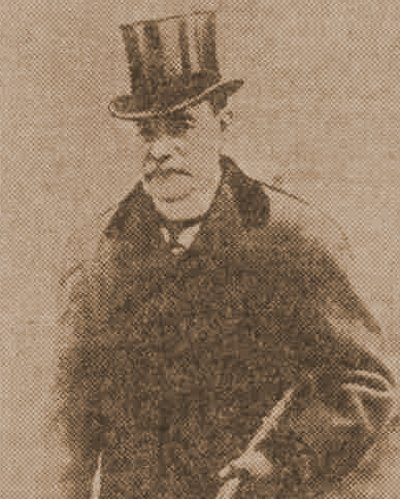 A photograph of Sir Melville Macnaghten in a top hat in 1913.