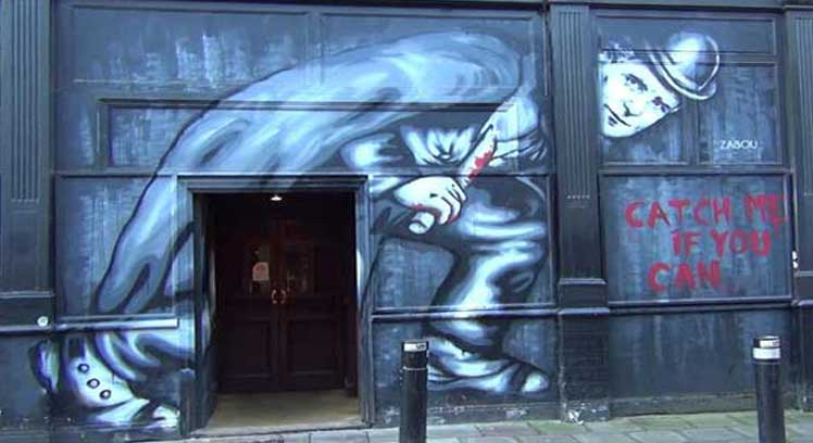 Jack the Ripper street art saying catch me when you can.