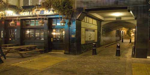 A photograph of the White Hart Pub on Whitechapel High Street.