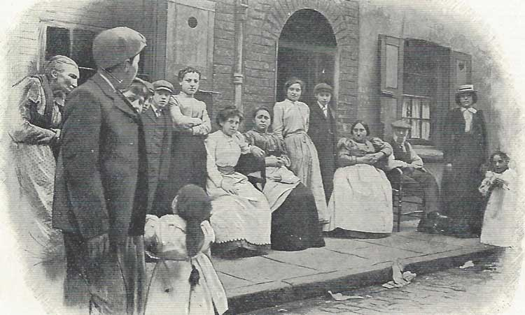 Jewish East End residents outside their houses.